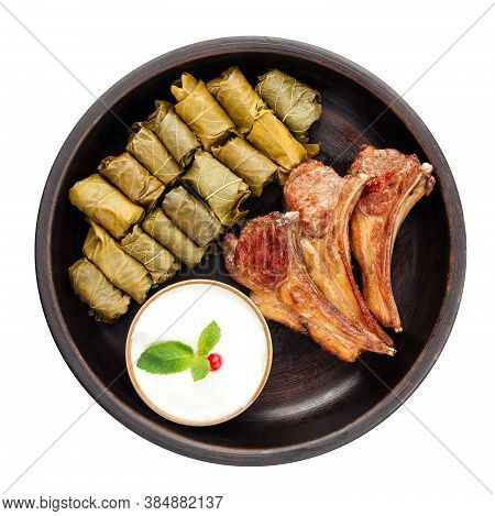 Top View On Dish Of Azrbaydzhan Cuisine With Dolma Lamb Entrecote Isolated On White