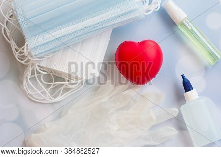 Protective Medical Mask And Medications For Doctors. Antiseptic Gloves And Thermometer