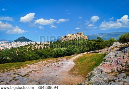 Beautiful View Of Acropolis Hill And Lycabettus Hill In Background In Athens, Greece From Pnyx Hill