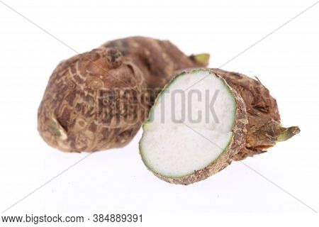 Group Of Sweet Taro Root Isolated On White Background Arbi Or Aravi Roots With One Cut In Cross Sect