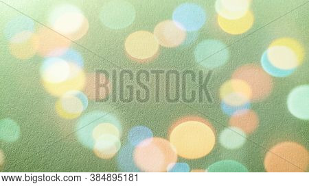 Green Background With Bokeh Effect. A Calm Green Hue Reminiscent Of A Grassy Tone. Soothing Interior