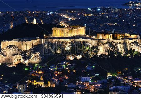 Close View Of Acropolis Parthenon And Erechtheion, Philoppapos Monument At Night. City Lights Of Ath