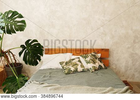 Bedroom Interior Bed And Nesr Table With Plant