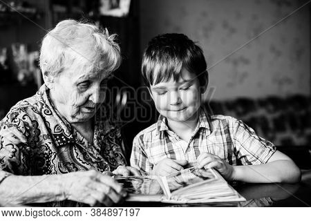 An old woman and grandson. Black and white photo.