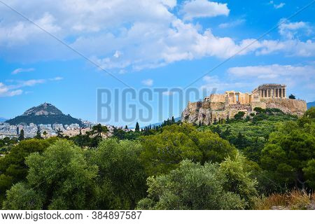 Iconic Vew Of Acropolis Hill And Lycabettus Hill In Background In Athens, Greece From Pnyx Hill In S