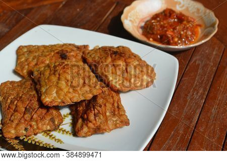 Fried Tempe With Homemade Indonesian Chili Sauce Served On A Wooden Table