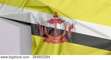 Brunei Darussalam Fabric Flag Crepe And Crease With White Space, Red Crest On Yellow Field Cut By Bl