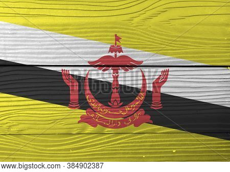 Flag Of Brunei Darussalam On Wooden Wall Background. Grunge Brunei Flag Texture, Red Crest On Yellow