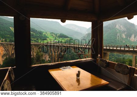 View From The Cafe On The Mountain, Beautiful And Impressive Landscape Of The Mountains And The Brid