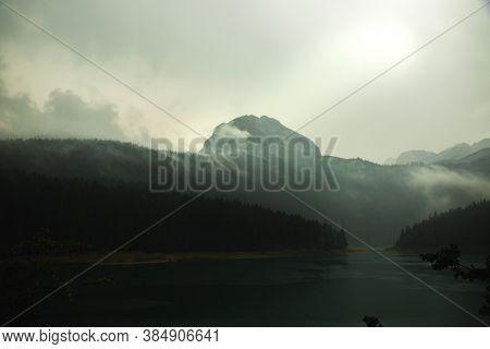 Gloomy Mountain Near The Lake, Foggy Day In The Montenegro, Travel To Europe