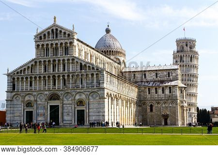 Pisa, Italy - March 17, 2012: People Walking Near The Pisa Baptistery Of St. John And The Leaning To