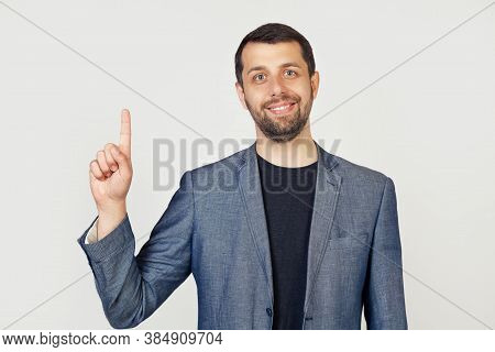 Young Businessman Man With Beard Smiling, Showing Number One With Fingers On Hand, Smiling Confident