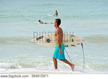 Holmes Beach, Anna Maria Island, Fl / Usa -  October 4, 2013: Surfers On Anna Maria Island Taking Ad
