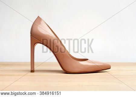 Fashion High Heels Women Shoes Beige Color. Stiletto Shoe Style In Ladies Wardrobe. High Fashion And