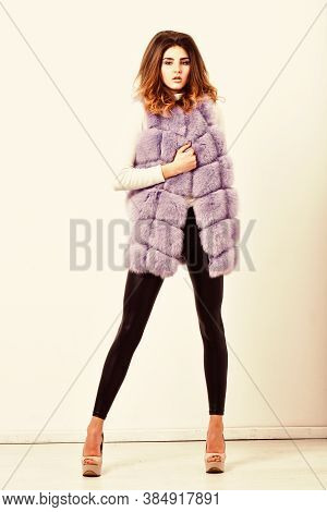 Woman Makeup Face Wear Fur Vest White Background. Luxury Fur Clothes For Female. Fashion Trend Conce