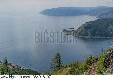 Top View Of  Green Mountains Near The Bay Of Blue Lake Baikal The Mouth Of The Angara River From The