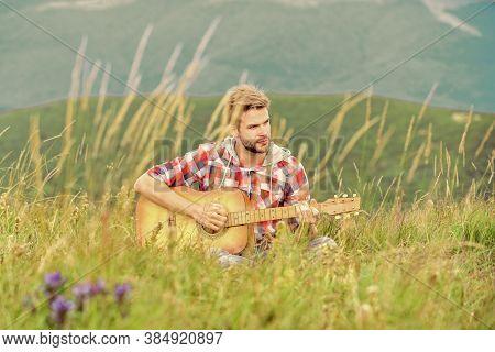 Hipster Musician. Inspiring Environment. Man Musician With Guitar On Top Mountain. Inspired Musician