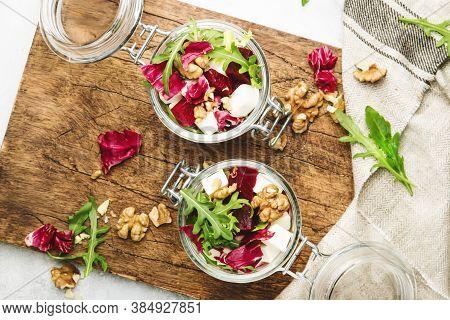 Beet Salad With Fresh Arugula, Soft Goat Cheese And Walnuts, Trendy Salad Jar, Steel Fork, Gray Kitc