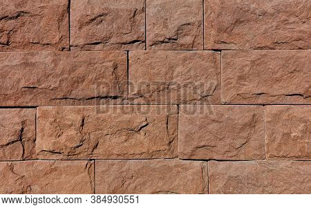 Wall Background And Texture Of Brown Granite Tiles With Chips Around The Perimeter, Close-up.