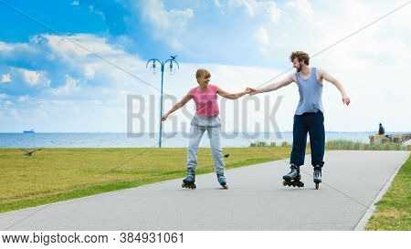 Active Holidays, Exercises, Relationship Concept. Young Woman And Man Dressed Up In Sporty Way, Hold