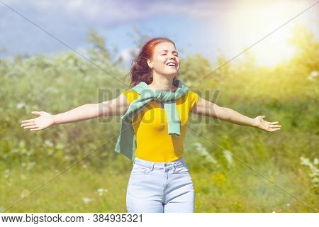 Happy, Relaxed Woman Breathing Deep Fresh Air In Nature, A Young Female With Red Hair, Resting With