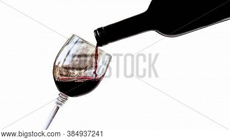 Wine Pouring From A Wine Bottle Into A Wine Glass,isolated On A White Background, Close-up.