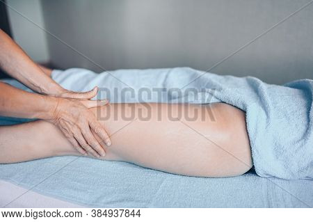 Young Unrecognizable Woman Lying On Massage Table And Enjoying Therapeutic Massage. Body Care, Losin