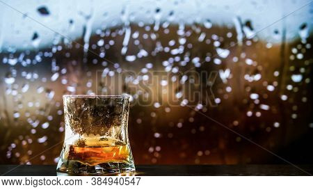 A Glass Of Whiskey,brandy On The Counter,an Alcoholic Drink In A Glass Of Whiskey.against The Backgr