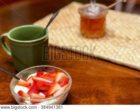 Fresh Cut Strawberries In A Glass Bowl Make For A Great Late Night Snack Accompanied By A Cup Of Hot