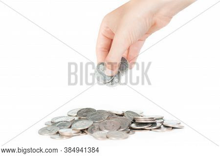 Kid's Putting Us Quarters On Top Of A Coins's Pile, On A White Background