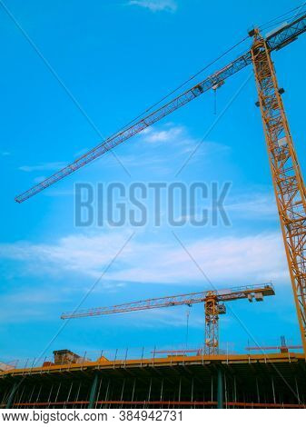 construction site with crane with blue sky