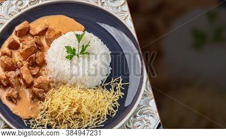 Chicken Stroganoff With Rice And Chips. Top View. Space For Text.