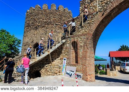Sighnaghi, Kakheti, Georgia - May 2, 2018: Tourists Climb Up The Stairs On Old City Wall In Sighnagh