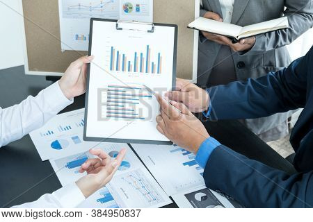 Three Business Leaders Talk About Charts, Financial Graphs Showing Results Are Analyzing And Calcula