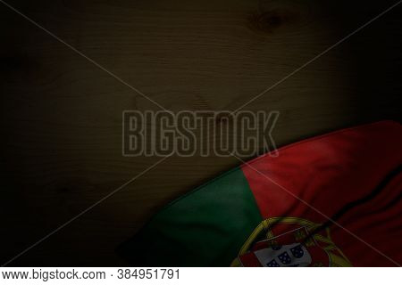 Pretty Dark Illustration Of Portugal Flag With Large Folds On Dark Wood With Empty Place For Your Co