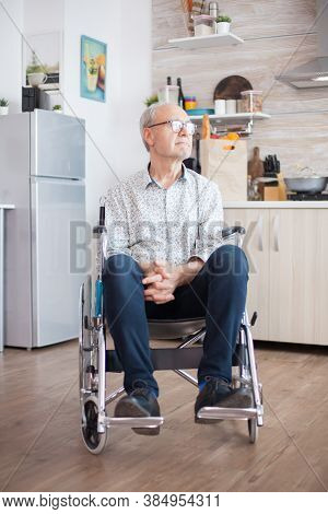 Lonely Handicapped Pensioner In Wheelchair Worrying About His Life. Elderly Handicapped Pensioner Af