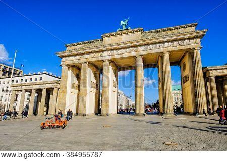 Berlin, Germany - March 24, 2017: People Admire Brandenburg Gate (brandenburger Tor) And Berlin Skyl