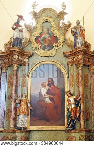 VUGROVEC, CROATIA - MAY 07, 2014: Altar of St. Joseph in the parish church of St. Francis Xavier in Vugrovec, Croatia
