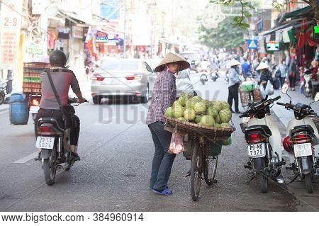 Hanoi, Vietnam, August 23, 2015: Life in Vietnam- Hanoi,Vietnam Street vendors in Hanoi's Old Quarte