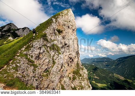 Young Woman Summerhiker With Backpack Climbingsteep Slopes, Walking On Panoramic Peaks Andmountai