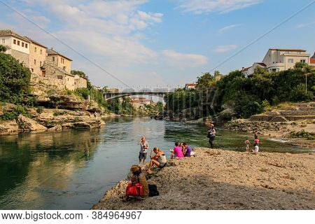 Mostar, Bosnia And Herzegovina - July 4th 2018: The Green Neretva River Underneath The Old Bridge In