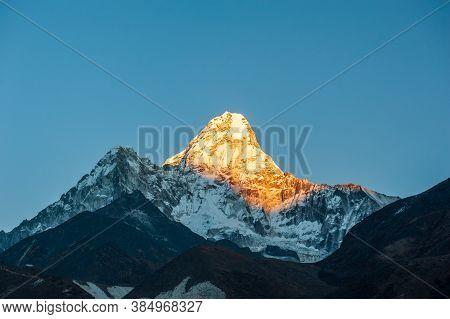 Sunrise On Ama Dablam Peak Mountain. Trekking In Nepal Himalayas. Ebc (everest Base Camp Trek) Trail