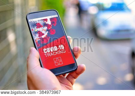 Corona Virus Tracking App Concept With Hand Holding Cell Phone With Application Design On Screen In