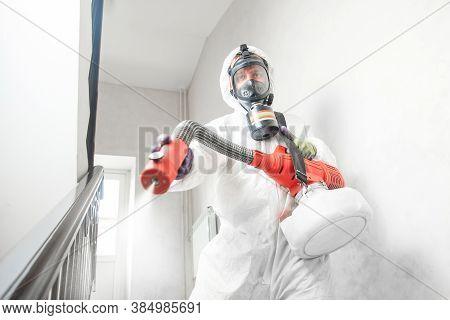 Disinfecting Prevent Covid-19, Specialist In Hazmat Suit With Disinfect In Hotel. Concept Coronaviru