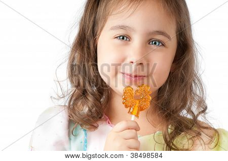 Little Girl Smiling And Eating Candy