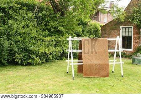 Warfum. May-16-2019. Carpet Over A Wooden Drying Rack For Airing. In A Open Air Museum