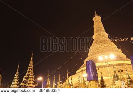 Night Shot Of The Shwedagon Pagoda, Also Known As The Golden Pagoda, Yangon Myanmar. It Is A Gilded