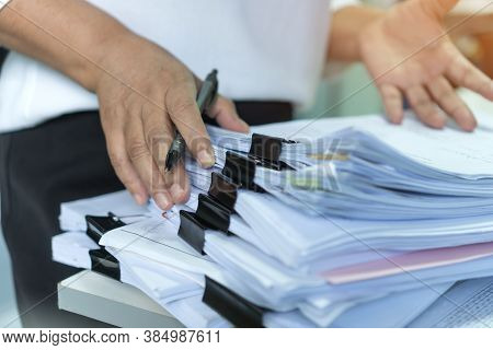 Stacks Of Lot Documents Report Papers With Clips Waiting Be Managed By Office Workers Arranging On D