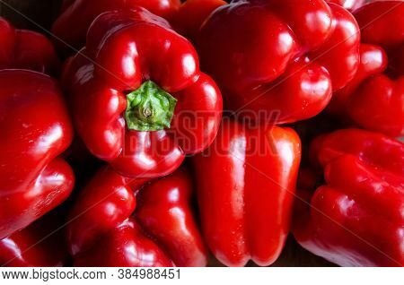 Close-up Red Bell Peppers Background With Copy Space. Ripe Red Peppers In The Kitchen. Paprika Filli