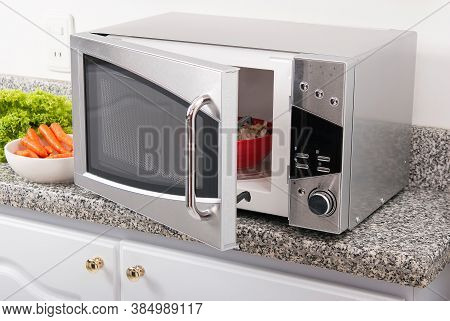 Microwave Oven; Photo In The Kitchen Environment.